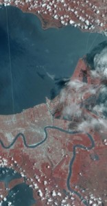 In this portion of a July 21, 2002 scan of New Orleans, the image has been color-processed to reflect data collected from multiple bands, including infrared, which shows up as the bright red. (Image: NASA)