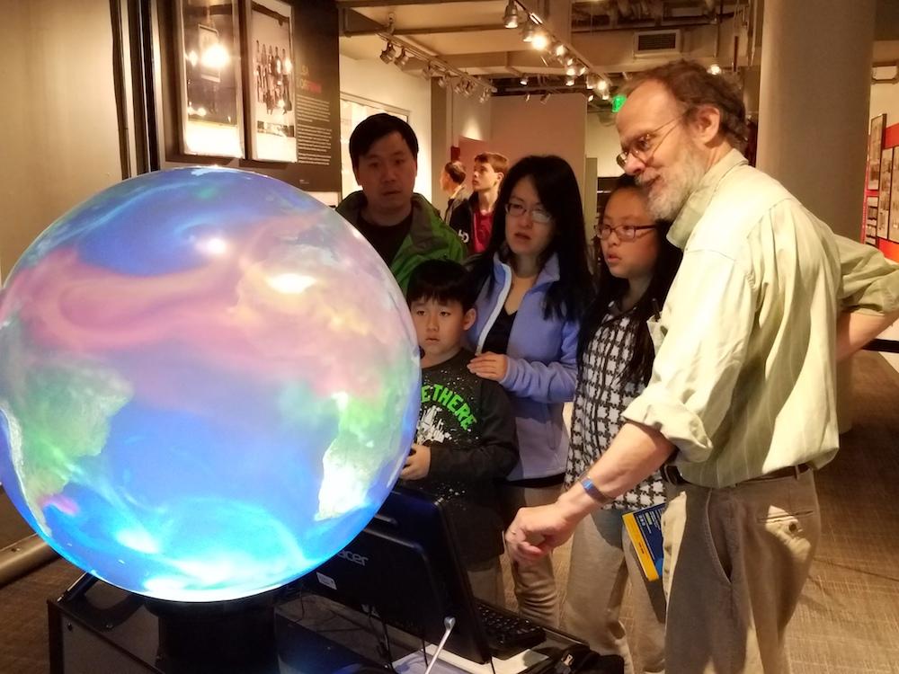 Oceanographer Glenn Flierl explains ocean and atmospheric processes using the iGlobe. (Photo: Lauren Hinkel)