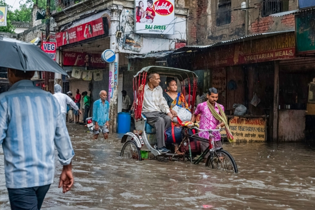 """""""The Indian monsoon is considered a textbook, clearly defined phenomenon, and we think we know a lot about it, but we don't,"""" says Senior Research Scientist Chien Wang. An image from Varanasi, India, shows flooding in 2011."""